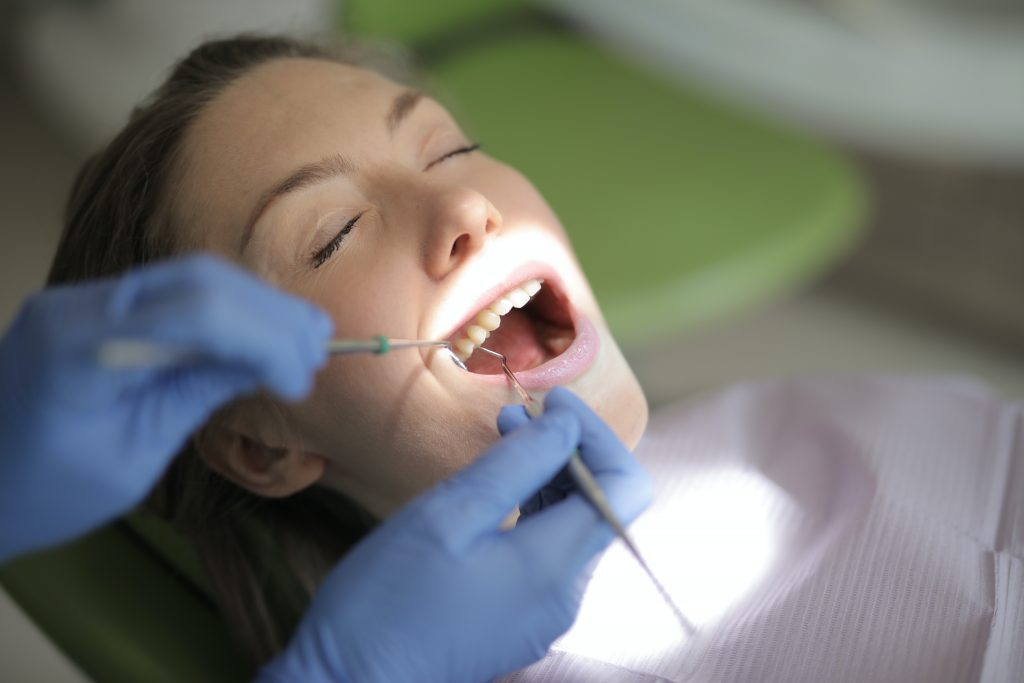 Dental Implants- woman at the dentist