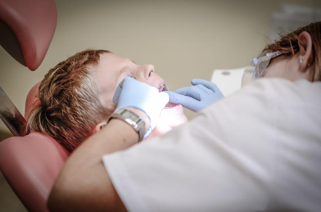 wisdom teeth removal - boy at the dentist
