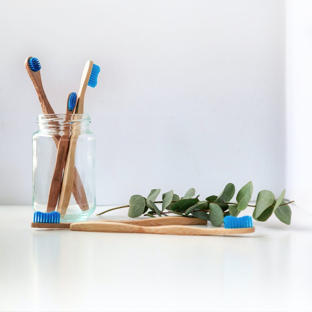 Dentist Sunshine Coast - bamboo and blue toothbrush in glass